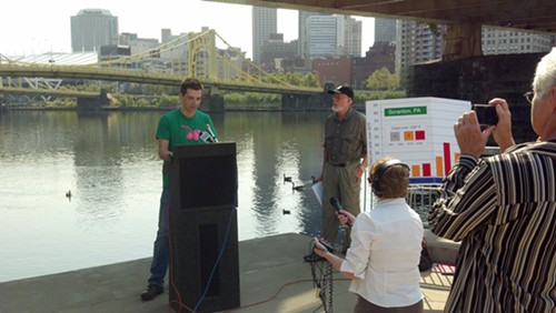 Trevette Hooper, owner of Oaklands Legume restaurant, speaks at a press conference about climate change Thursday under the Roberto Clemente Bridge on the North Side.
